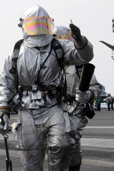US Navy 081022-N-3659B-039 Sailors assigned to the crash and salvage team walk the perimeter of an aircraft