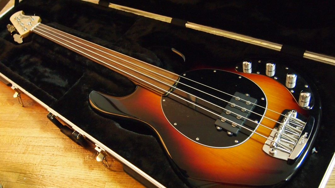 Music Man StingRay fretless bass in case angled