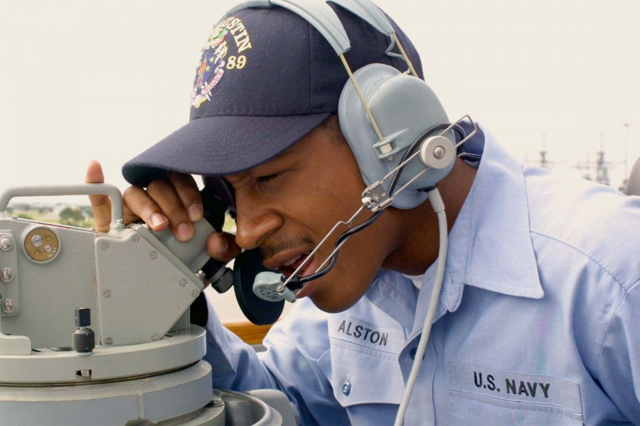 US Navy 030502-N-1350S-010 Operation Specialist Seaman Tyrone S. Alston conducts bearing checks during Sea and Anchor detail as Pre-commissioning Unit (PCU) Mustin (DDG 89) departs Pascagoula, Miss