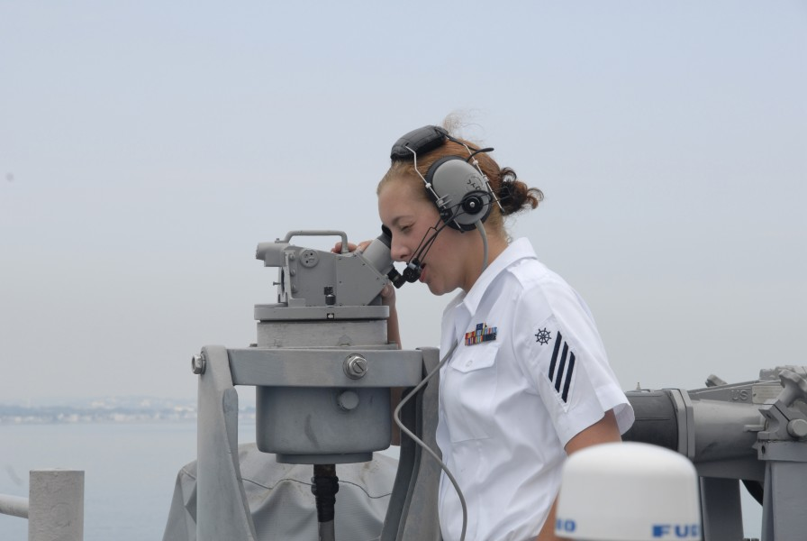 US Navy 080701-N-1928H-004 Quartermaster Seaman Amy Hover, assigned to the multi-purpose amphibious assault ship USS Bataan (LHD 5), takes bearings as the ship enters port in Boston