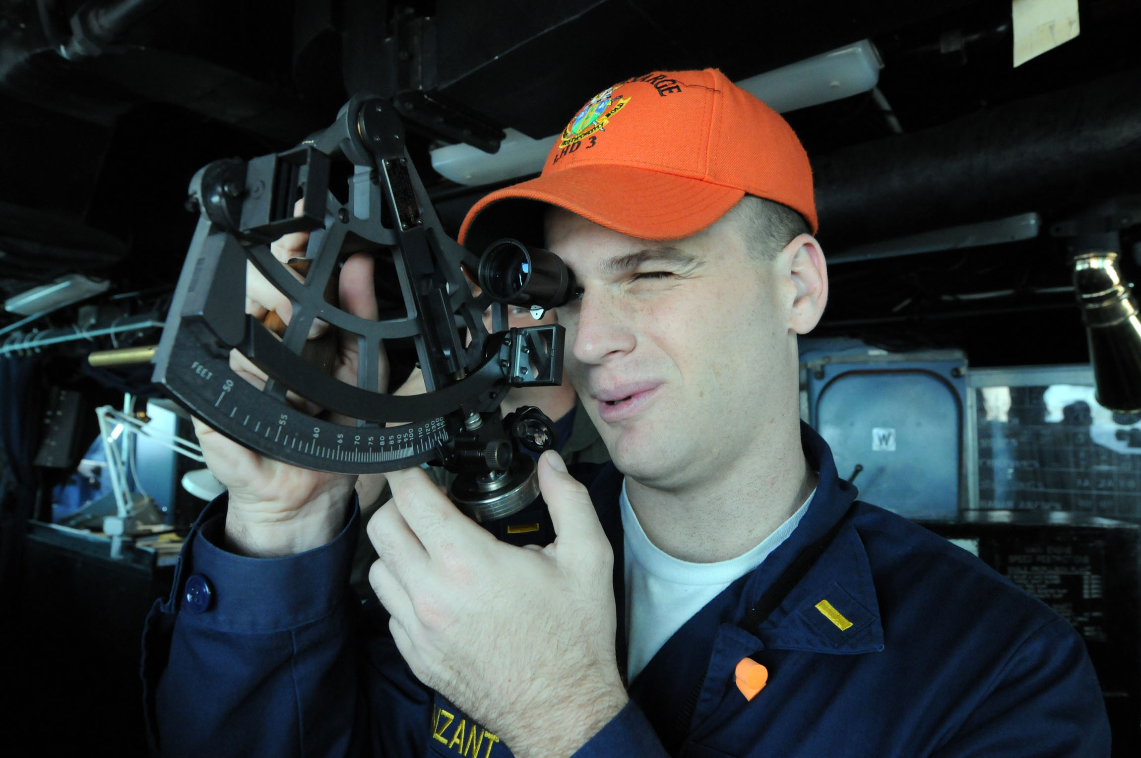 US Navy 081028-N-9774H-013 Ensign Timberon Vanzant determines the distance to another vessel through a stadimeter from the bridge of the amphibious assault ship USS Kearsarge (LHD 3)