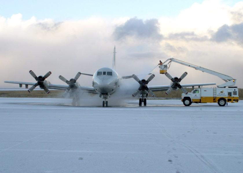 US Navy 061108-N-3013W-039 An Icelandic de-icing crew working for Keflavik International Airport sprays down the surface of a P3-C Orion before a flight