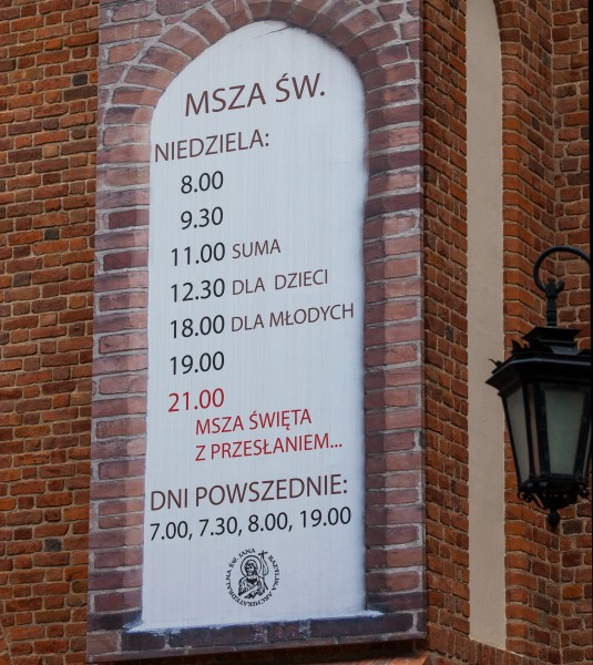a Holy Mass schedule at a church in Warsaw (Warszawa), Poland, June 2014, picture 8/9