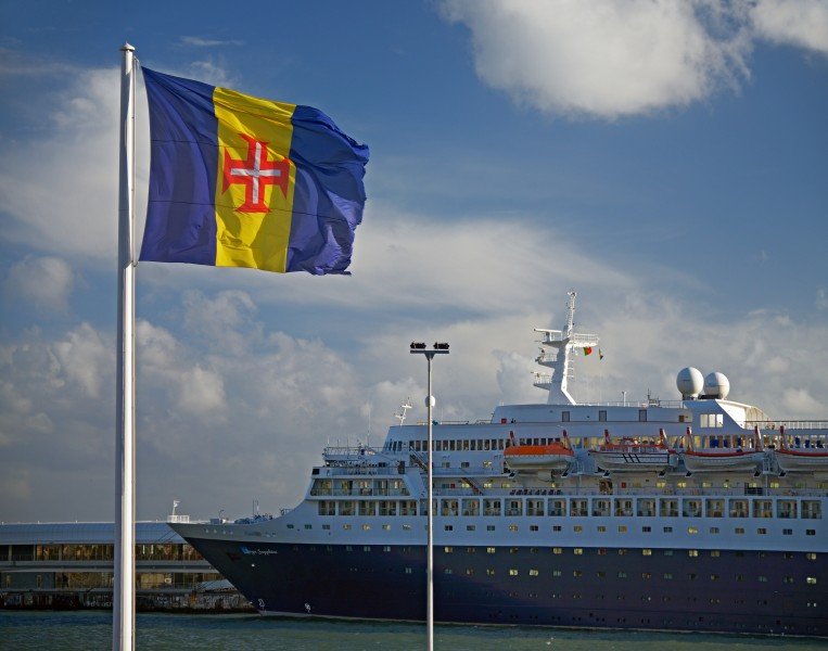Flag of Madeira and Saga Sapphire in the port of Funchal. Madeira, Portugal