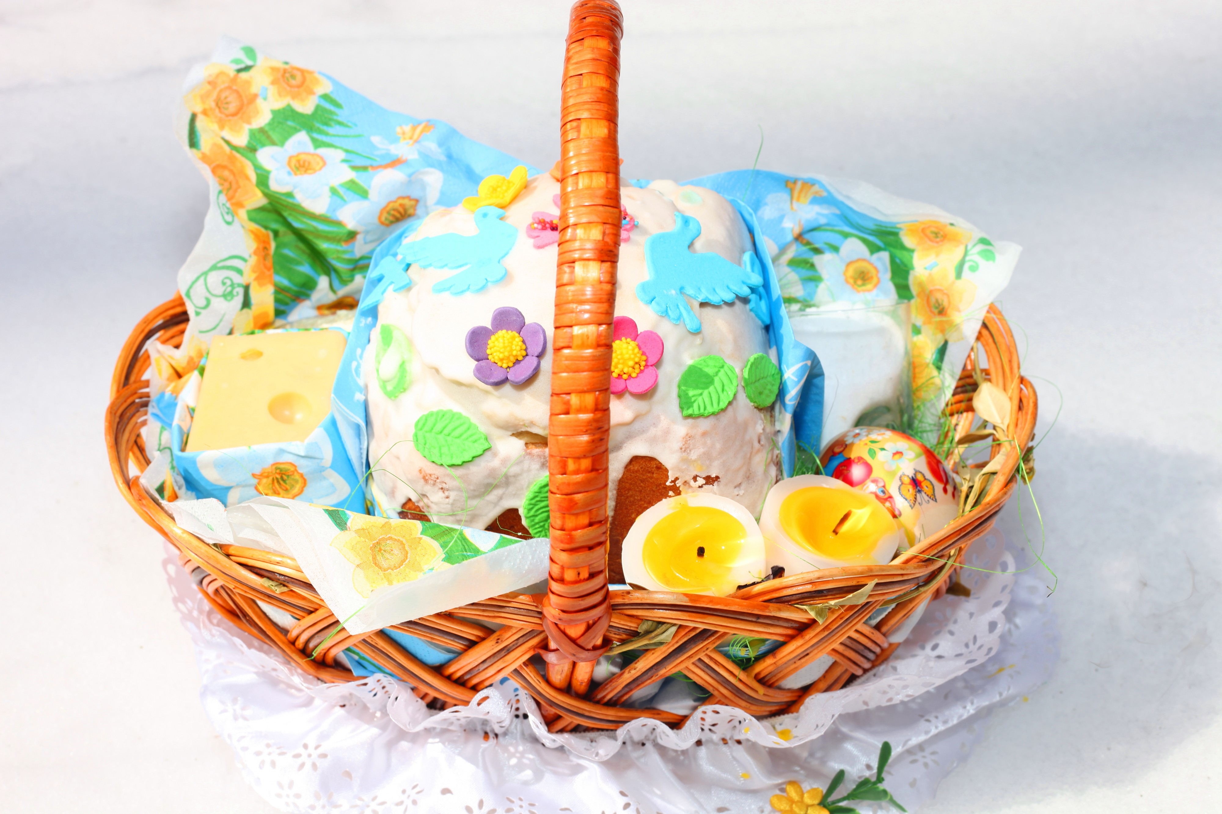 an Easter basket with foods and candles