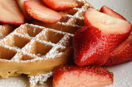 Waffle with strawberries and confectioner's sugar