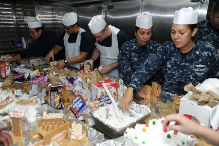 US Navy 111216-N-UE944-005 Sailors participate in a gingerbread house-building contest sponsored by the morale, welfare, and recreation department