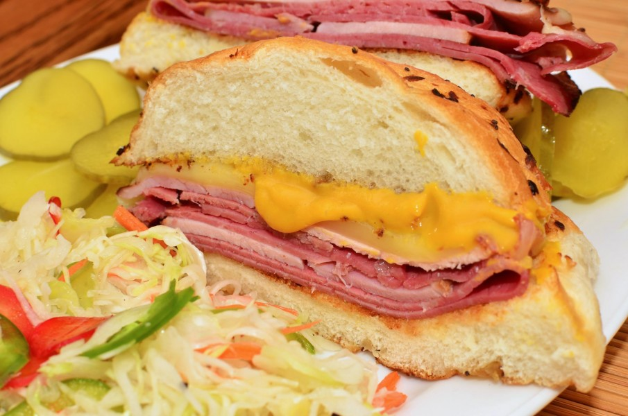 Mmm... ham, pastrami, and corned beef on an onion roll (6198207029)