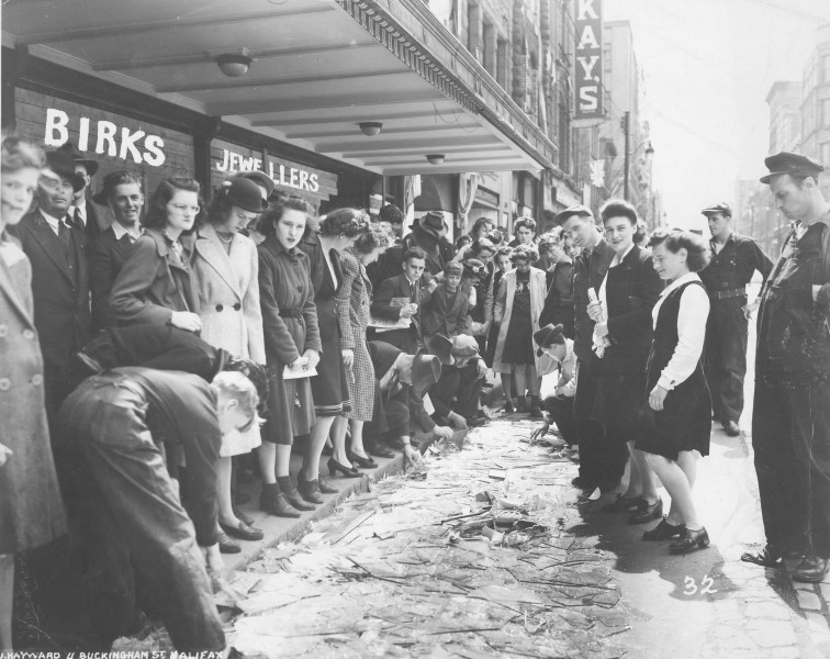 Crowd viewing broken glass on Barrington St., Halifax, after the Bedford Magazine Explosion, 18 July, 1945