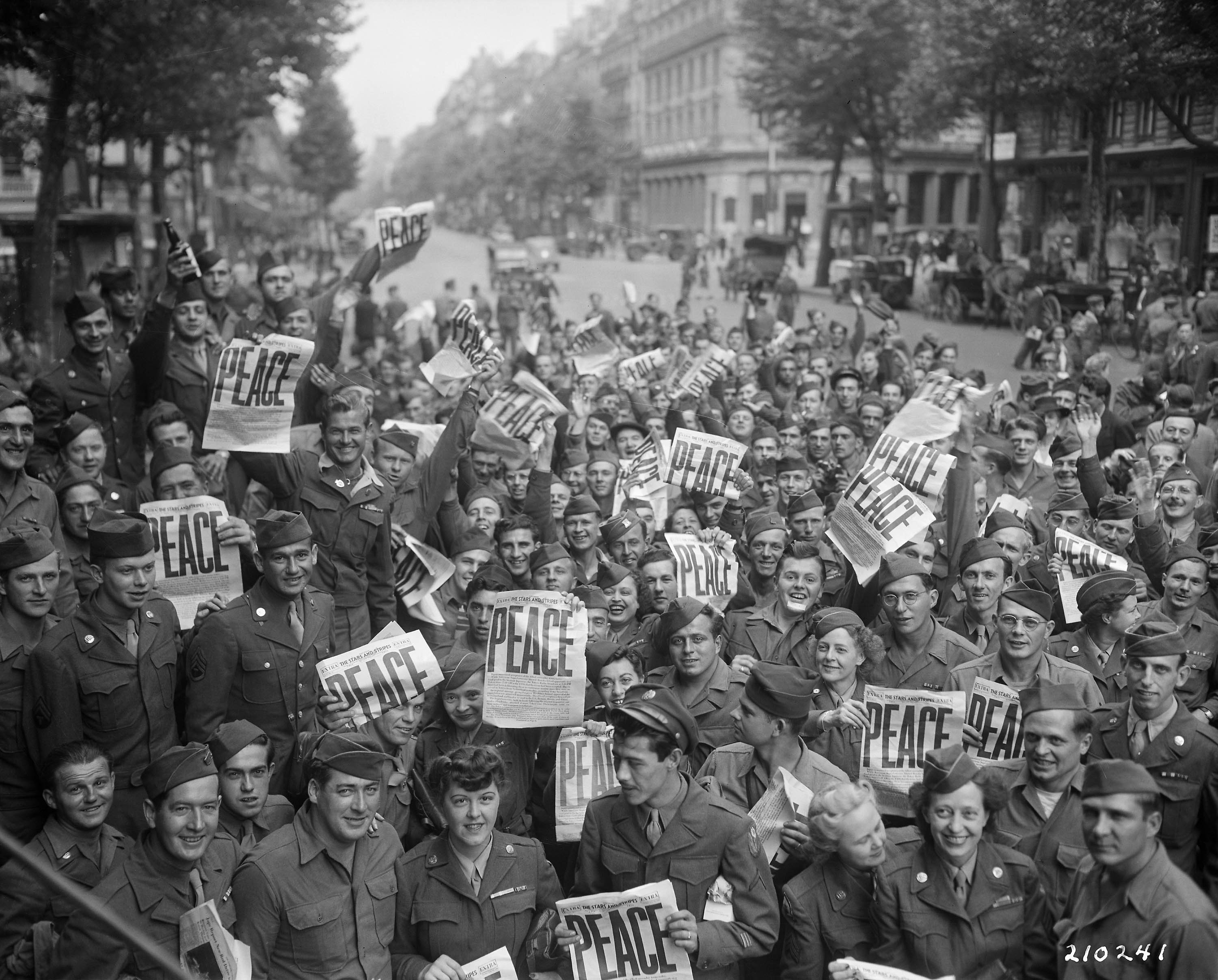 American military personnel gather in Paris to celebrate the Japanese surrender
