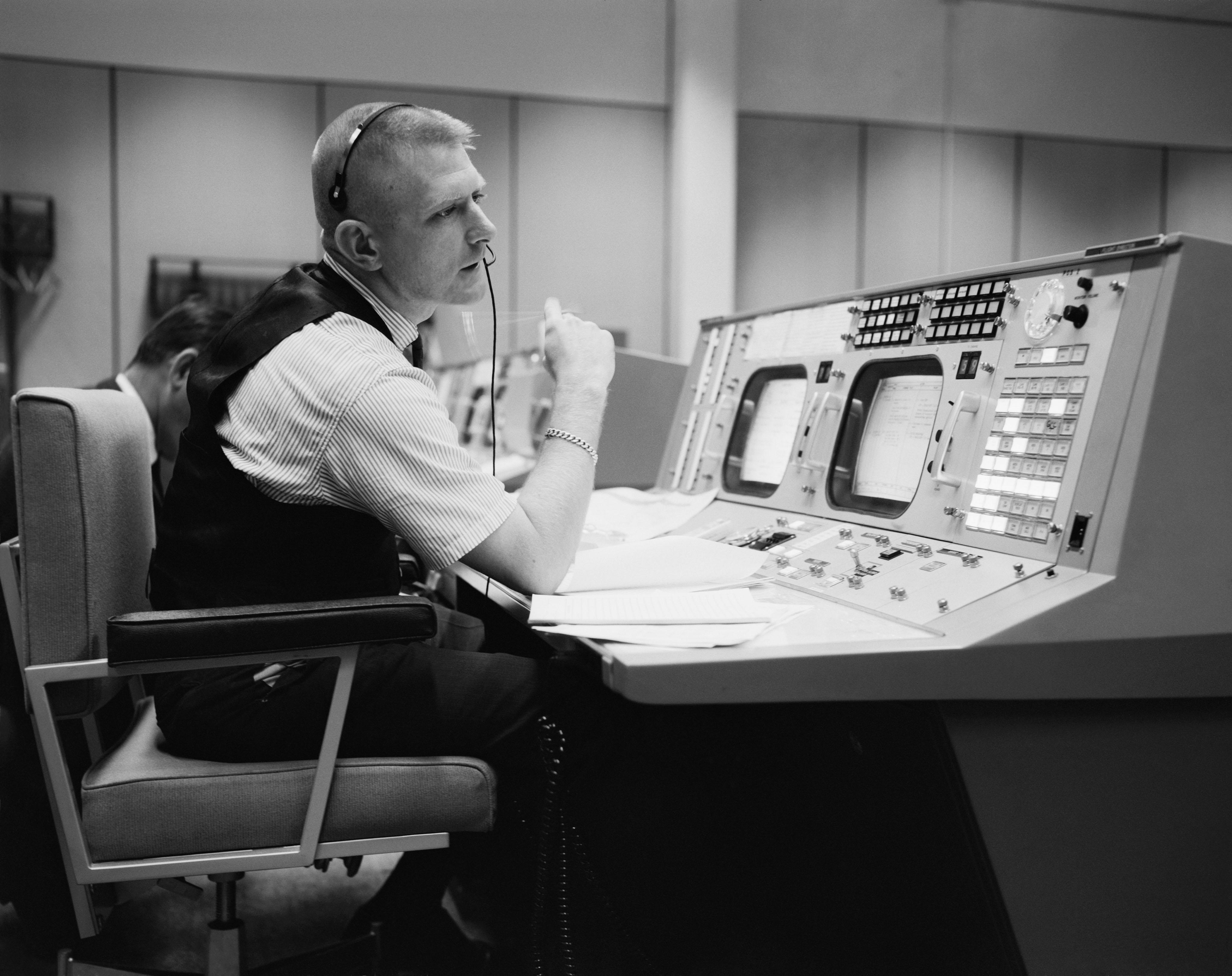 Eugene F. Kranz at his console at the NASA Mission Control Center