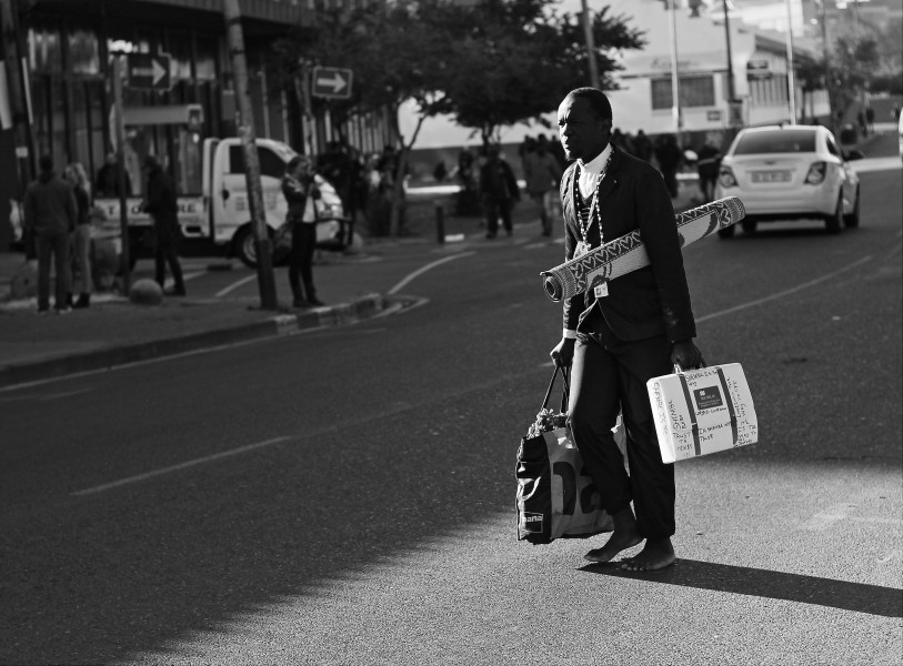 A traditional dance performer, barefooted and on his way to work (Doornfontein, 2015)