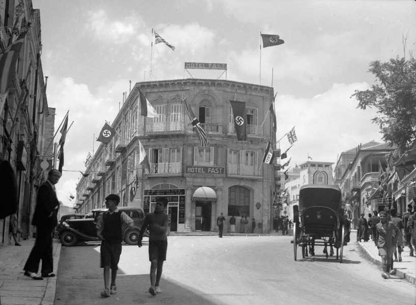 British and Nazi flags flying from the Fast Hotel. matpc.16994