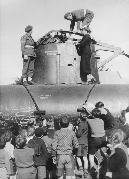 Children inspecting a Japanese midget submarine, 1942 (3702945655)