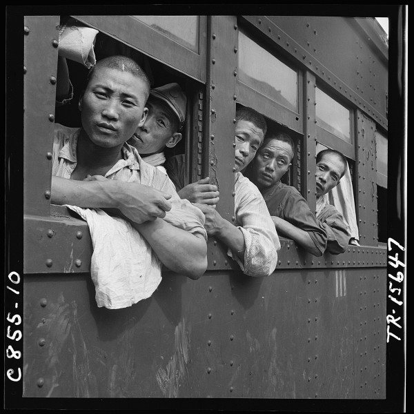 Discharged Japanese soldiers crowd trains as they take advantage of free transportation to their homes after end of... - NARA - 520938