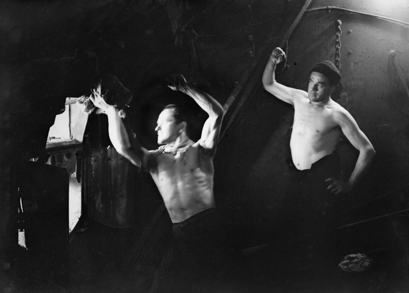 Stokers in the boiler room on board HMT STELLA PEGASI, Scapa Flow, 6 June 1943. A17189