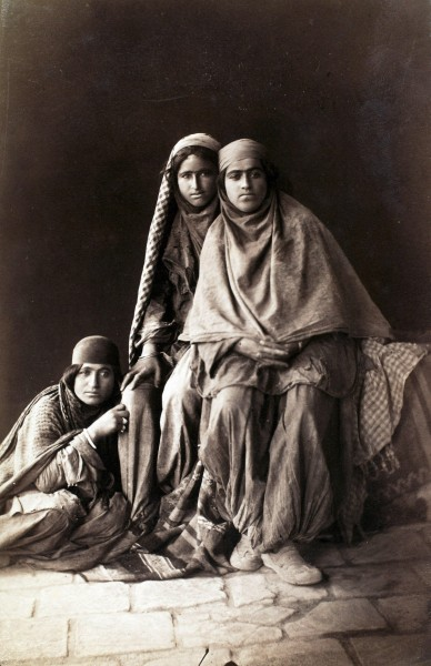 Three women tiredly look at Antoin Sevruguin as he photographs them in the late 19th century.