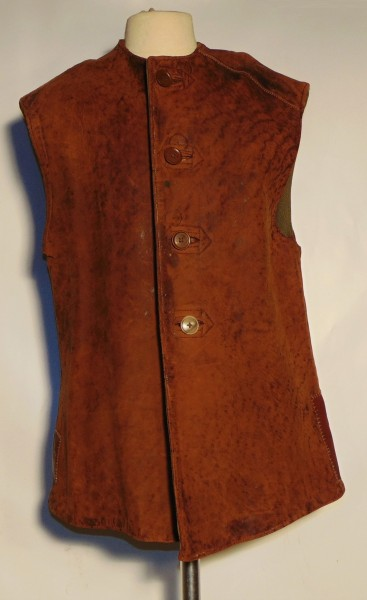 Brown leather sleeveless waistcoat, British