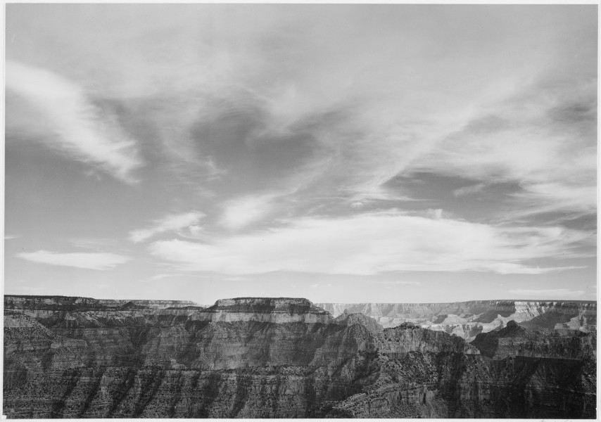 Canyon edge, low horizon, clouded sky,