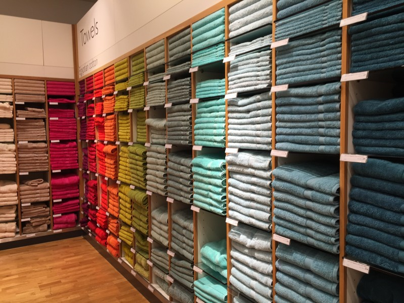 Multicoloured bath towels, John Lewis, Reading, UK - 20150711-01