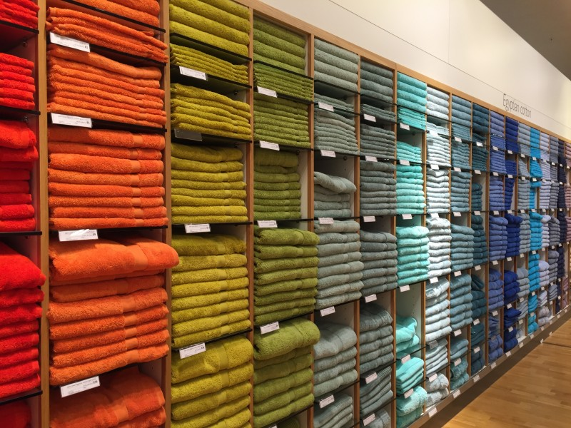 Multicoloured bath towels, John Lewis, Reading, UK - 20150711-02