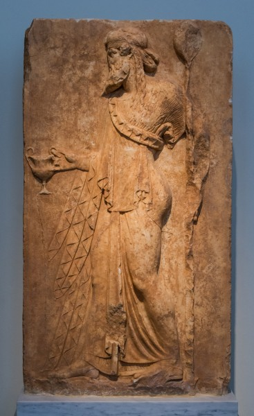NAMA 3727 Dionysos holding a kantaros and a thyrsos votive relief