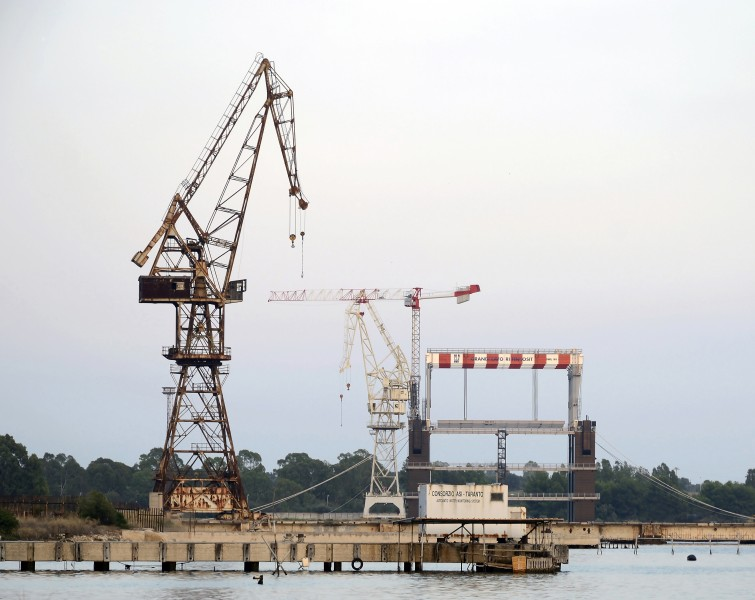 Old cranes abandoned at the port of Taranto