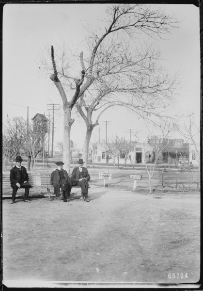 Three gentlemen pass the time on a park bench in San Jacinto Plaza, El Paso, Texas, 1906 - NARA - 523026