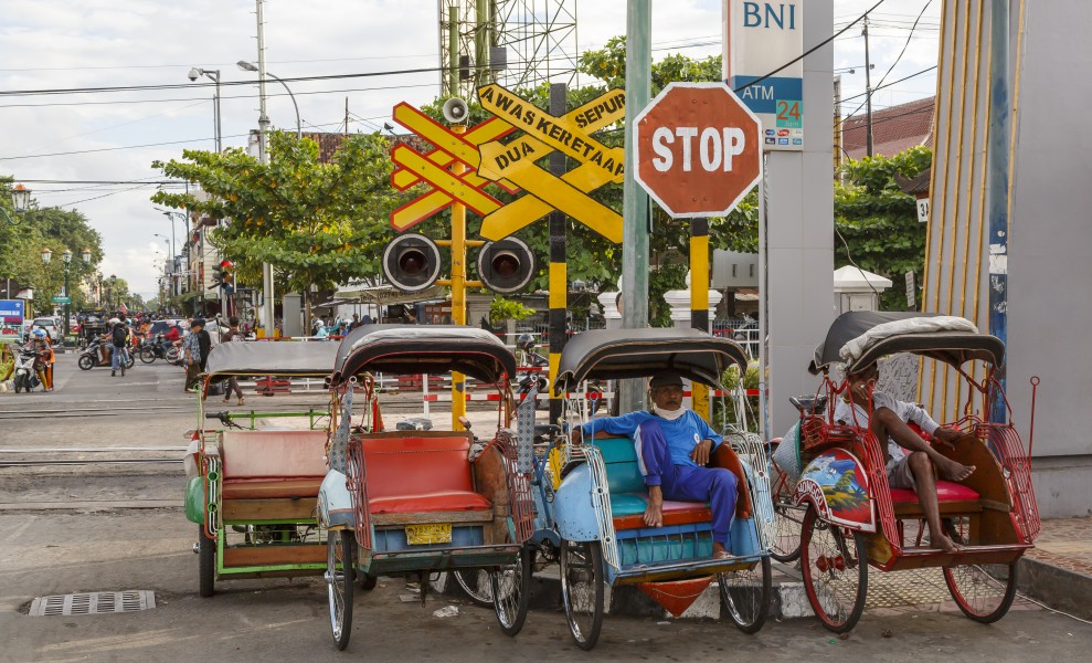 Yogyakarta Indonesia Rickshaws-waiting-at-level-crossing-for customers-01