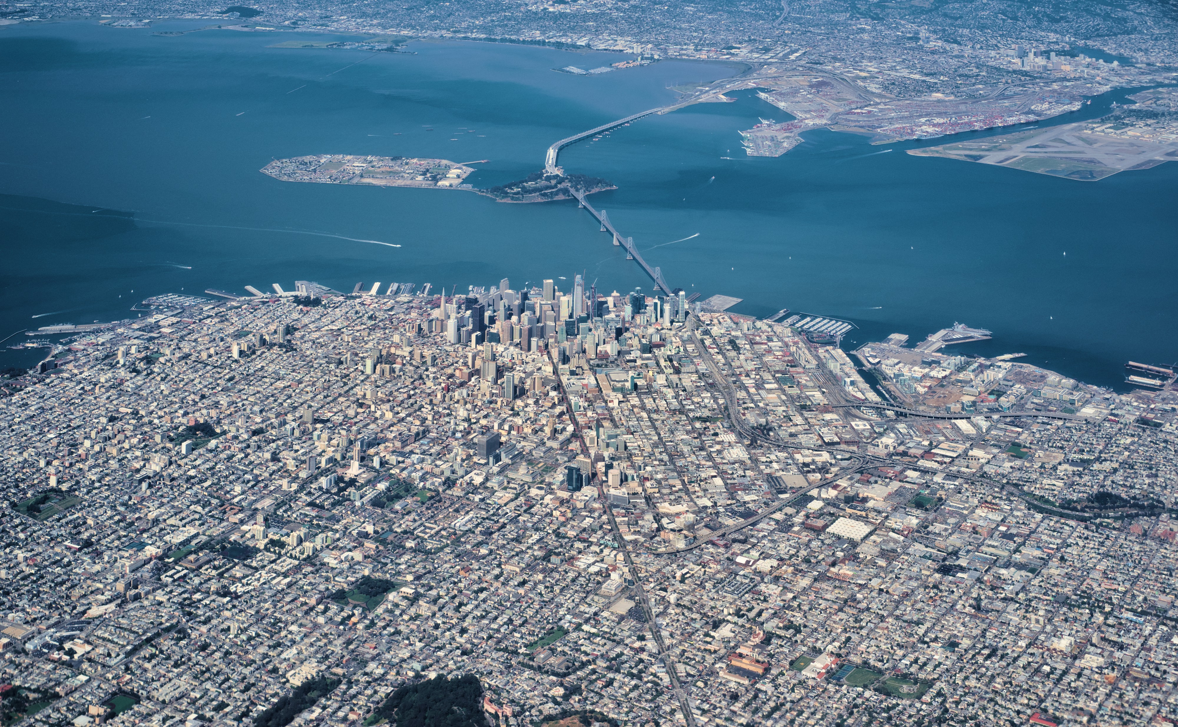 Aerial view of downtown San Francisco, the Bay Bridge, Treasure Island, and Oakland