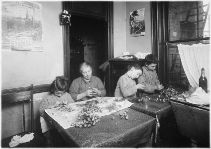 Basso family, making roses in dirty poorly lighted kitchen. Pauline, 6 years old, works after school. Peter, 8, works... - NARA - 523515
