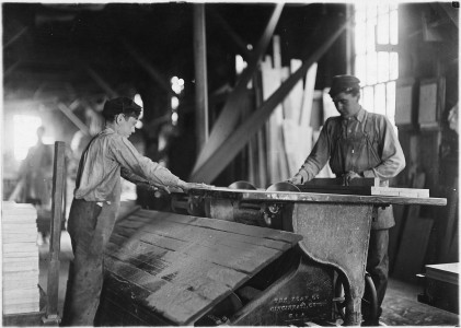 Boy working at double circular saws. N.Y. Dimension Supply Co. Evansville, Ind. - NARA - 523095