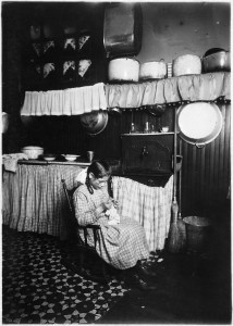 Camela, 12 years old, making Irish lace for collars. Works until 9 P.M. in dirty kitchen. New York City. - NARA - 523513