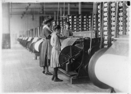 Girls running warping machines in Loray Mill, Gastonia, N.C. Many boys and girls much younger. Boss carefully avoided... - NARA - 523104