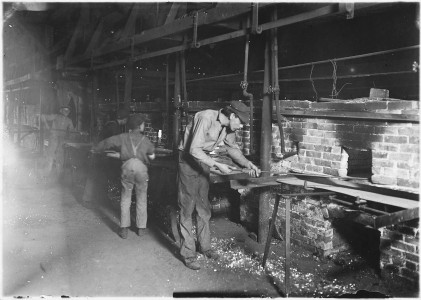 Putting bottles into the Annealing Oven. 1 A.M. Indianapolis, Ind. - NARA - 523080