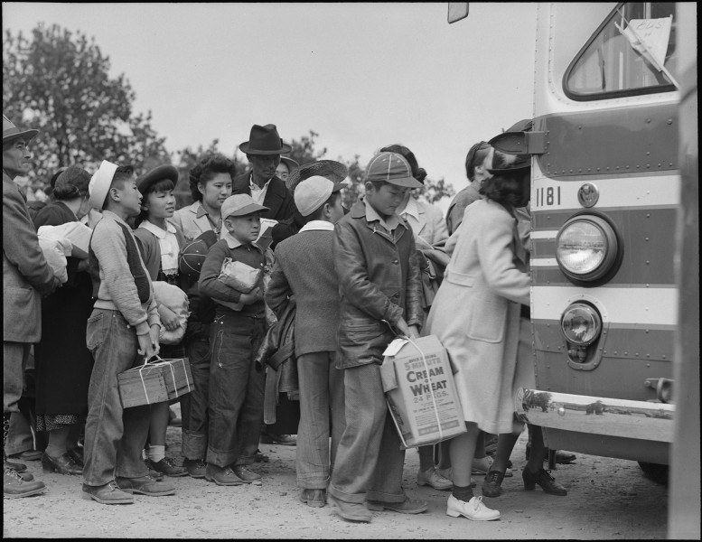 Centerville, California. Members of farm family board evacuation bus. Evacuees of Japanese ancestr . . . - NARA - 537584
