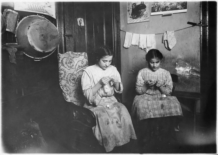 Katie, 13 years old, and Angeline, 11 years old, making cuffs, Irish lace. Income about $1 a week. Works some nights... - NARA - 523512
