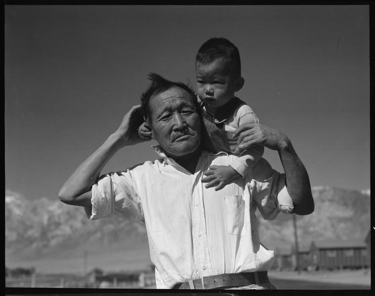 Manzanar Relocation Center, Manzanar, California. Grandfather and grandson of Japanese ancestry at . . . - NARA - 537992