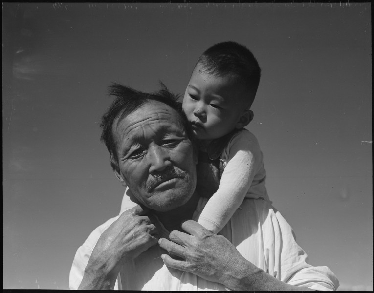 Manzanar Relocation Center, Manzanar, California. Grandfather and grandson of Japanese ancestry at . . . - NARA - 537994