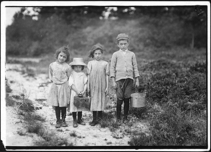 Three pickers going home from work. Anne, 7 years old, and brother Vincent said 11. Vincent picked last summer. Inez... - NARA - 523465