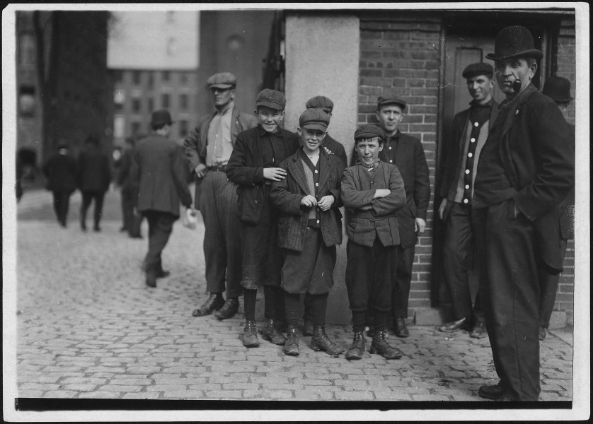 Workers in Merrimac Mill. Robert, smallest, 12 years old. Michael Keefe, next in size, about 13 or 14 years old.... - NARA - 523483