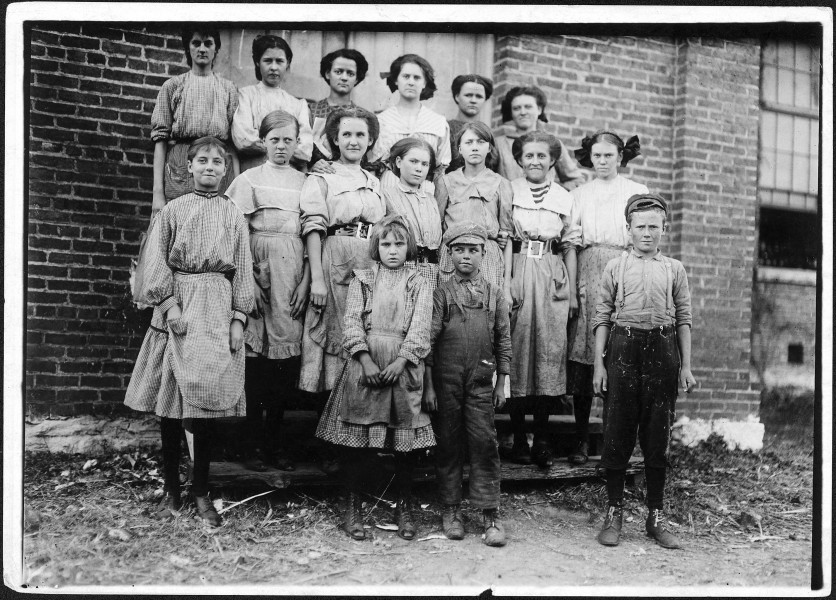 Young spinners in Elk Cotton Mills. Youngest girl hardly knew her name. Youngest boy runs two sides at ten cents each... - NARA - 523348