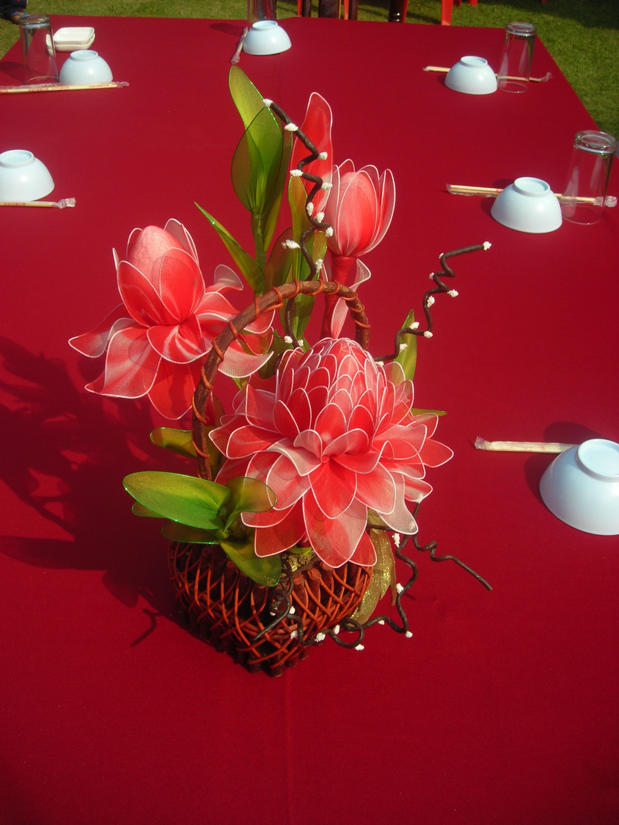 Red artificial flower as table decoration
