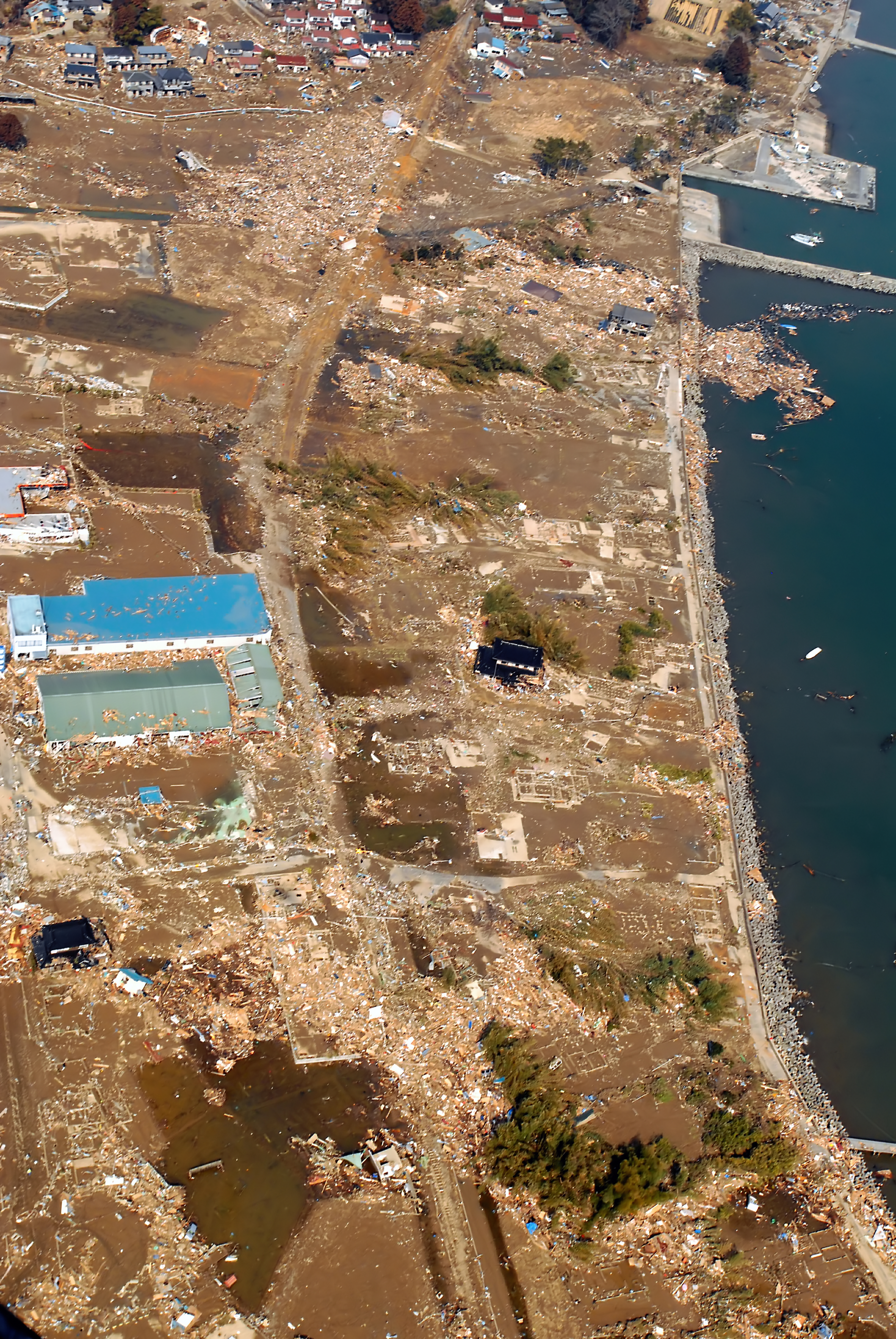 An aerial view of tsunami damage in an area north of Sendai, Japan, taken from a U.S. Navy helicopter-LF