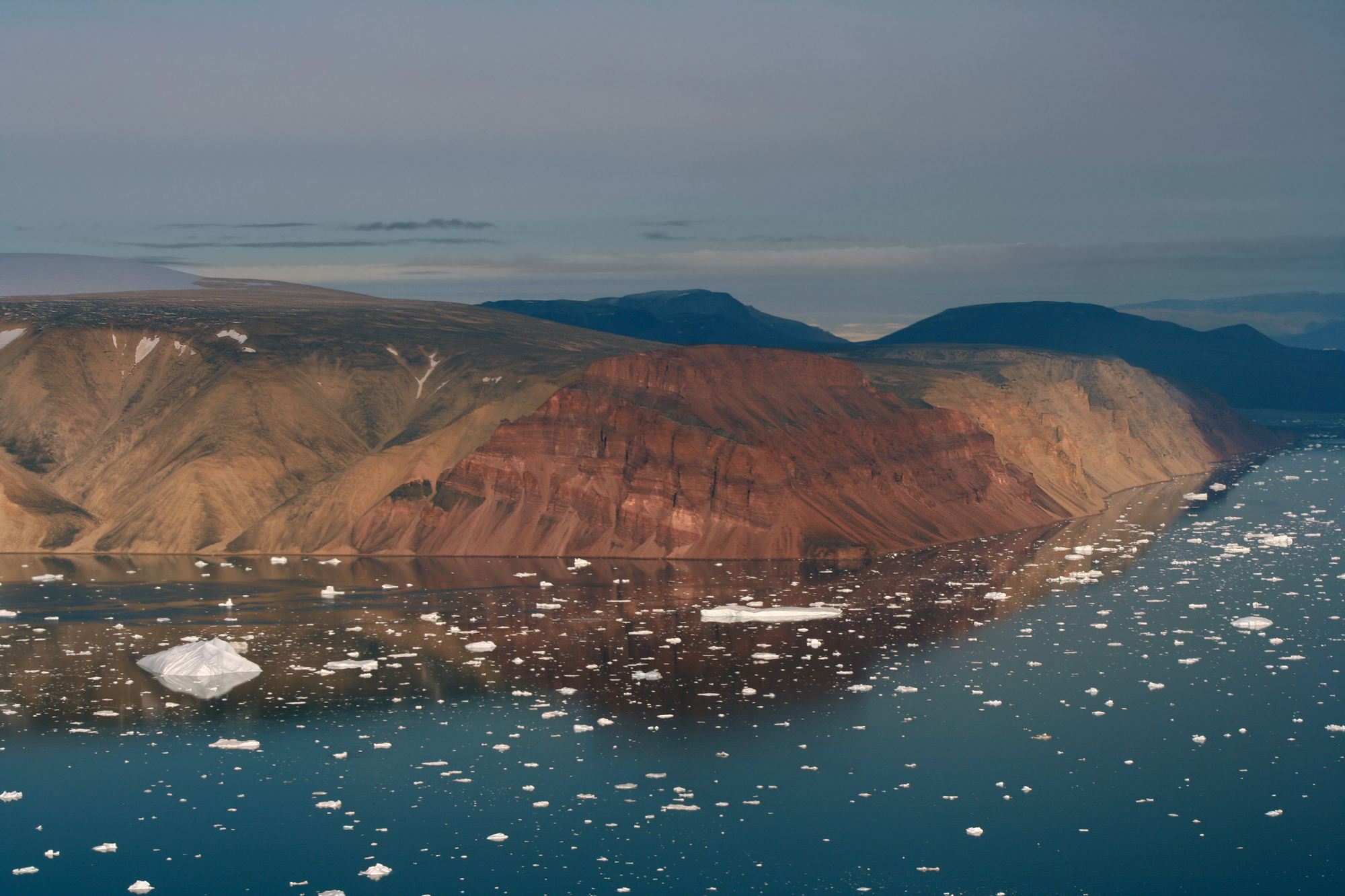 Red Cliffs and icebergs in Greenland