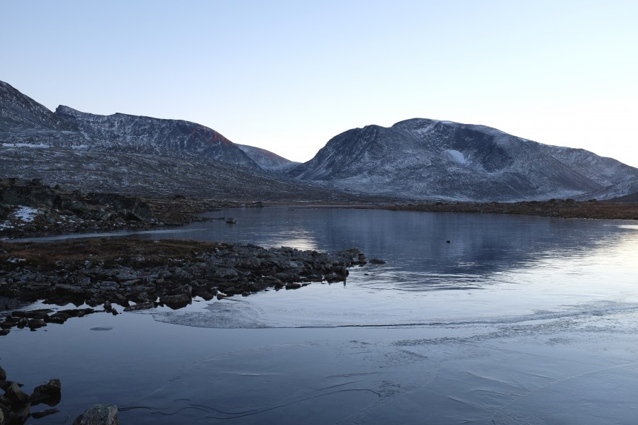 Thin layer of ice over Åmotsvatnet lake in Dovrefjell National Park, Norway