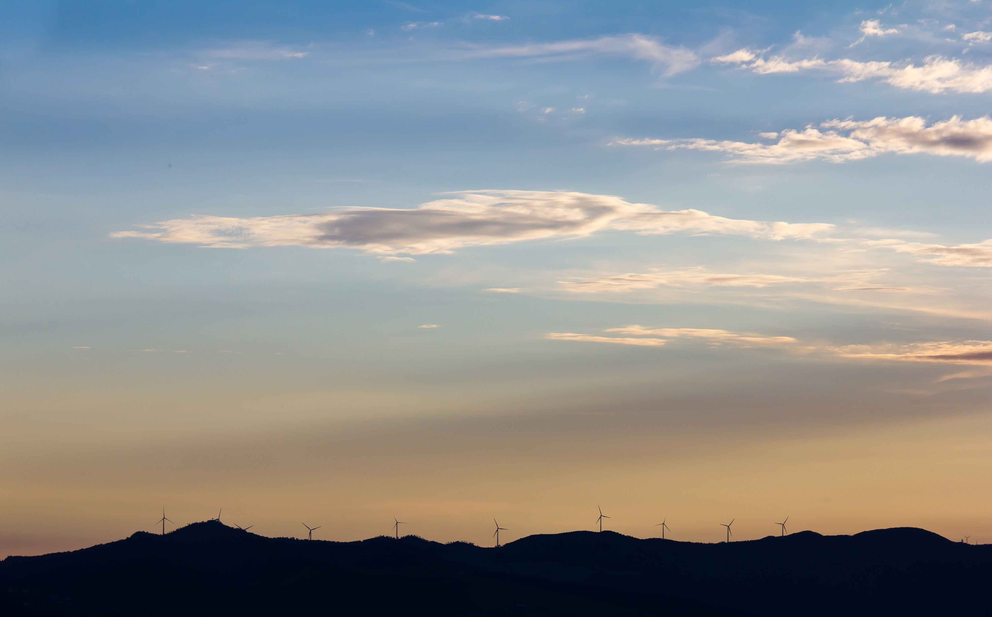 Twilight in Tuscany, wind turbines on a hill range-9944