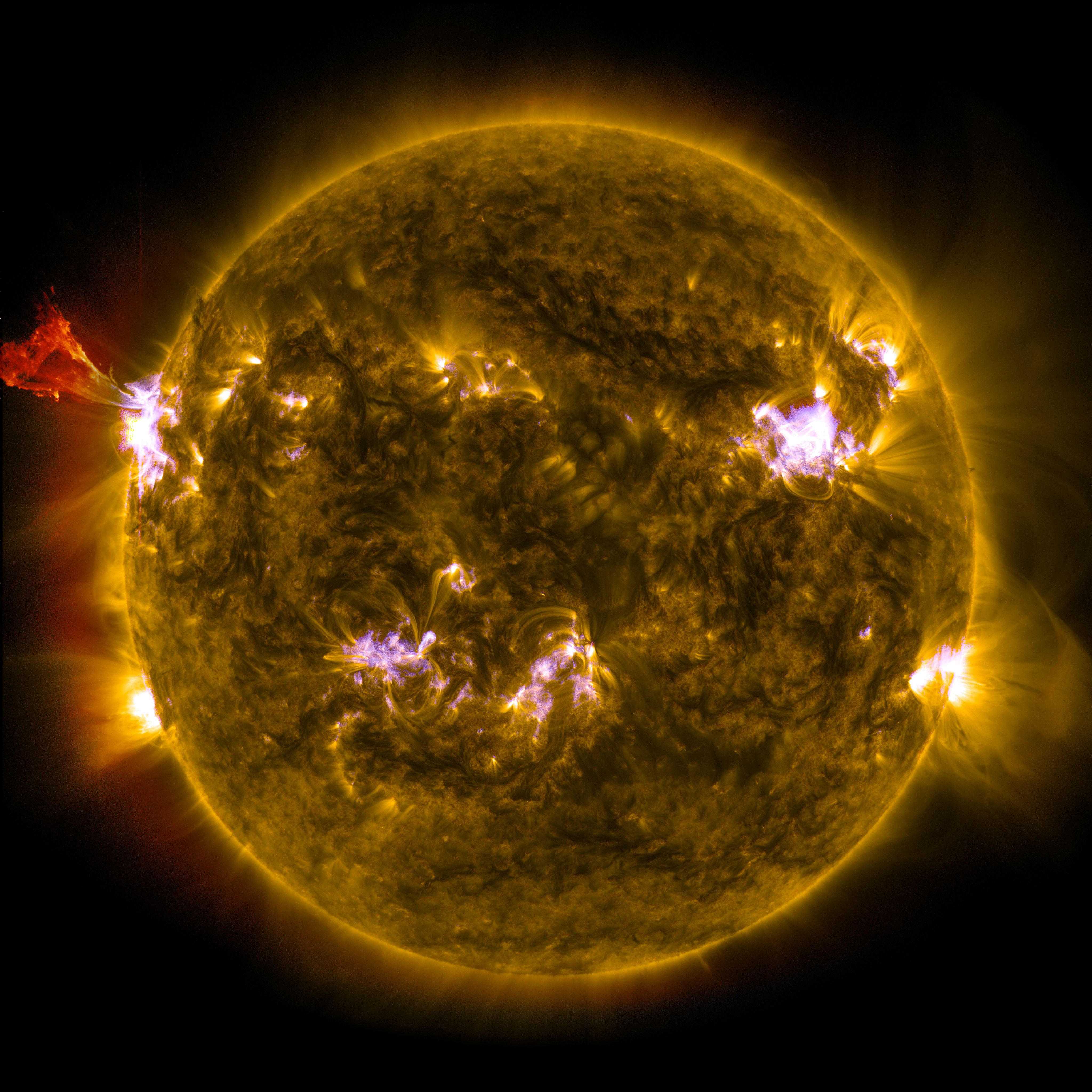 A burst of solar material leaps off the left side of the sun in what's known as a prominence eruption