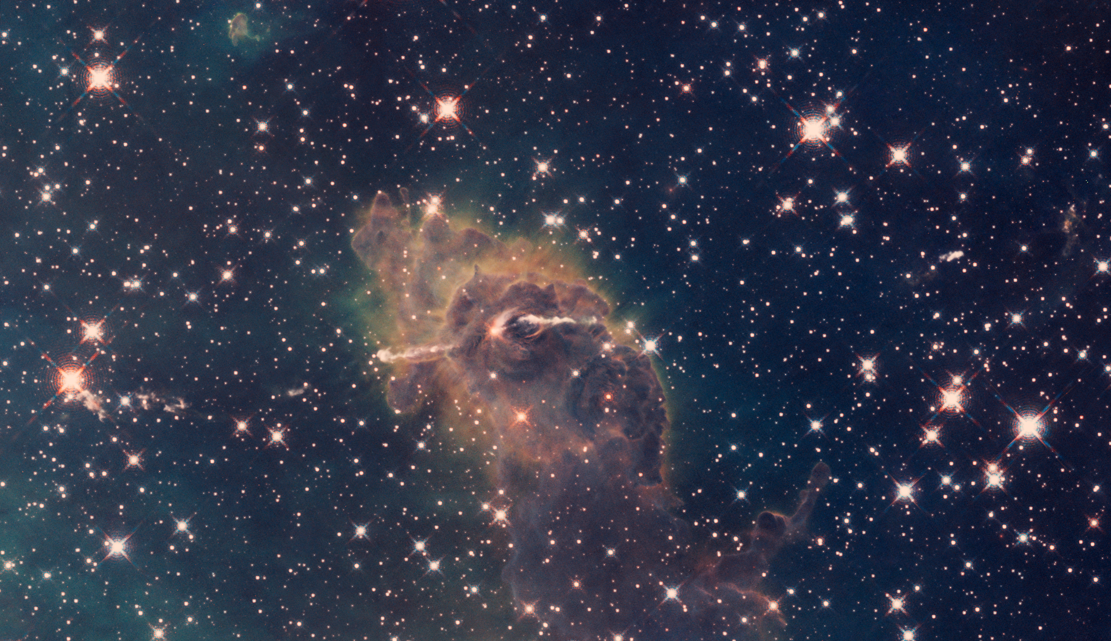 Carina Nebula composite of visible and infrared light (captured by the Hubble Space Telescope)