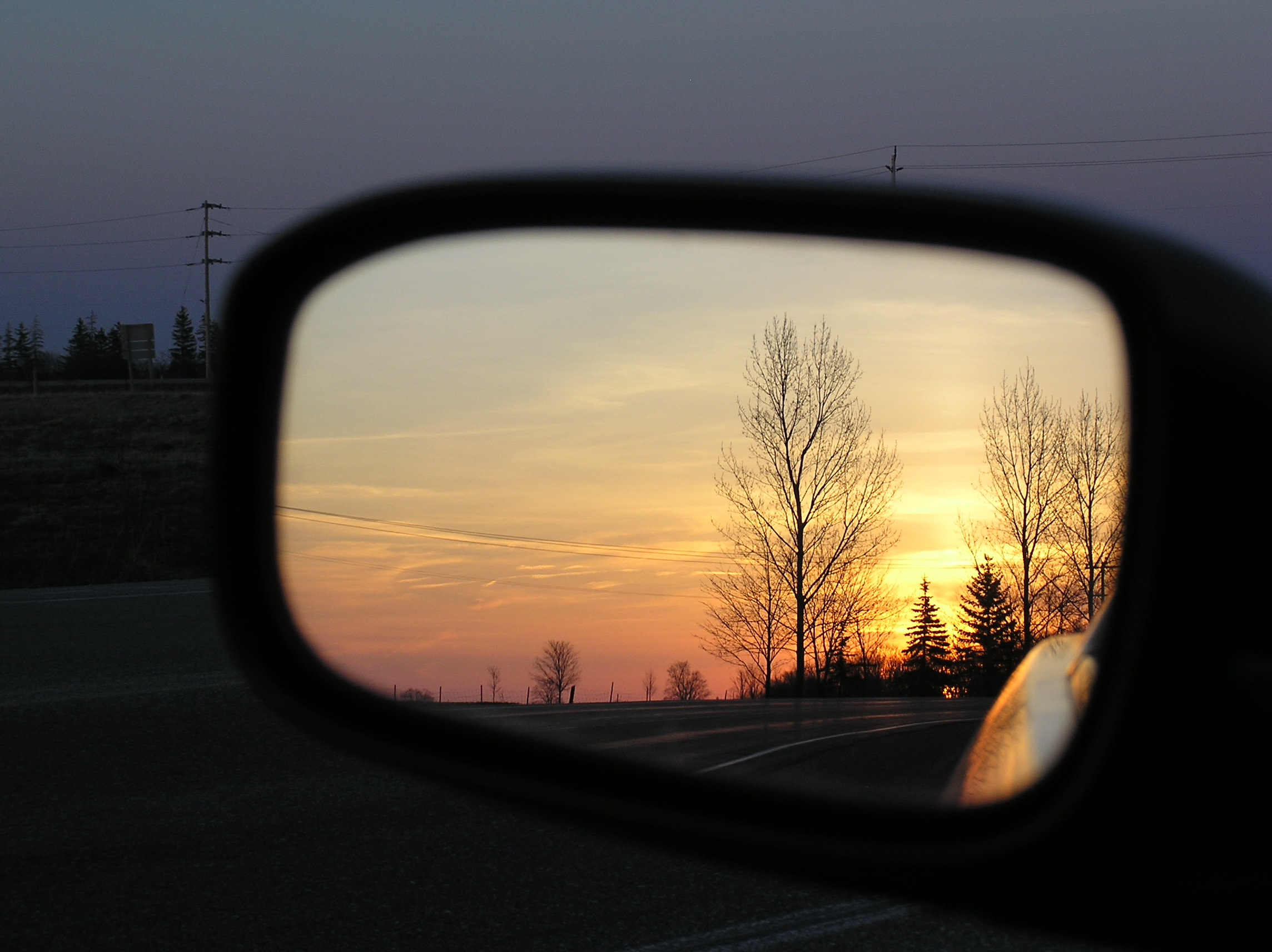 Car side mirror sunset